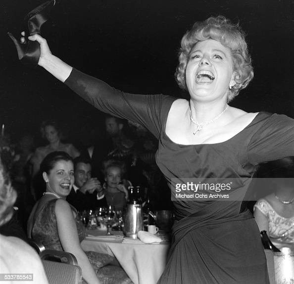 Actress Shelley Winters dances as Donnie Brooks sings during the 34th Academy Awards after party in Los AngelesCA