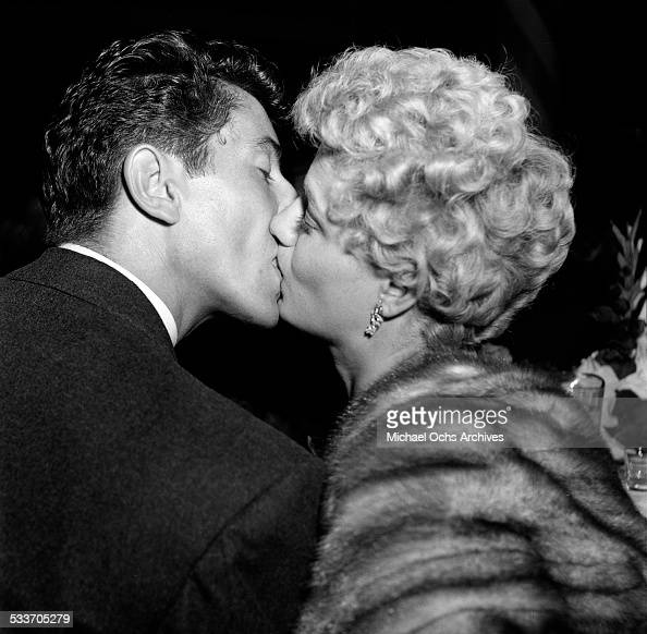 Actress Shelley Winters kisses actor Farley Granger during an event at Mocambo's in Los AngelesCA