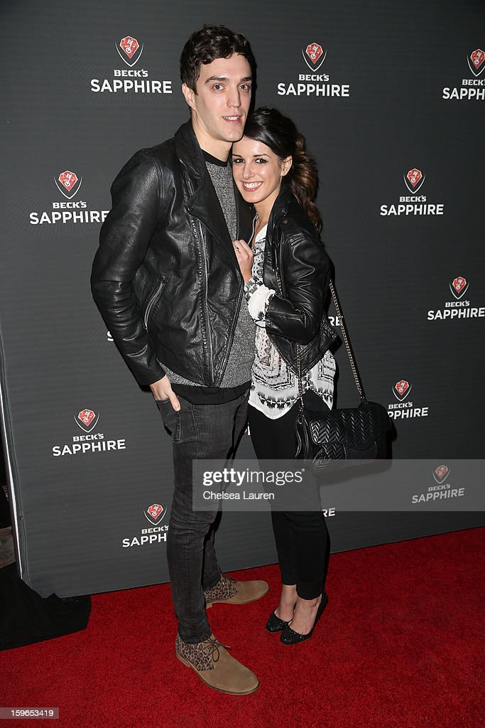 Actress Shenae Grimes (R) and fiance model Josh Beech arrive at the Beck's Sapphire launch event on January 17, 2013 in Beverly Hills, California.