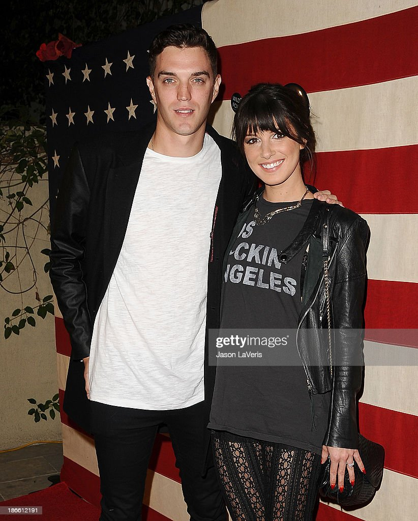 Actress <a gi-track='captionPersonalityLinkClicked' href=/galleries/search?phrase=Shenae+Grimes&family=editorial&specificpeople=2153141 ng-click='$event.stopPropagation()'>Shenae Grimes</a> (R) and husband Josh Beech attend Nylon Magazine's 'America The Issue' celebration at Sunset Marquis Hotel & Villas on November 1, 2013 in West Hollywood, California.