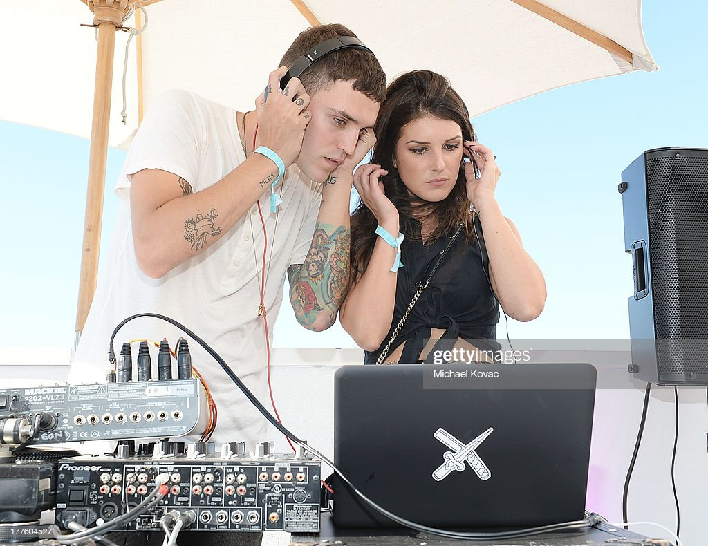 Actress <a gi-track='captionPersonalityLinkClicked' href=/galleries/search?phrase=Shenae+Grimes&family=editorial&specificpeople=2153141 ng-click='$event.stopPropagation()'>Shenae Grimes</a> (R) and Josh Beech spin during BeautyCon LA, a fashion and beauty summit for the top digital influences online at Siren Studios on August 24, 2013 in Hollywood, California.