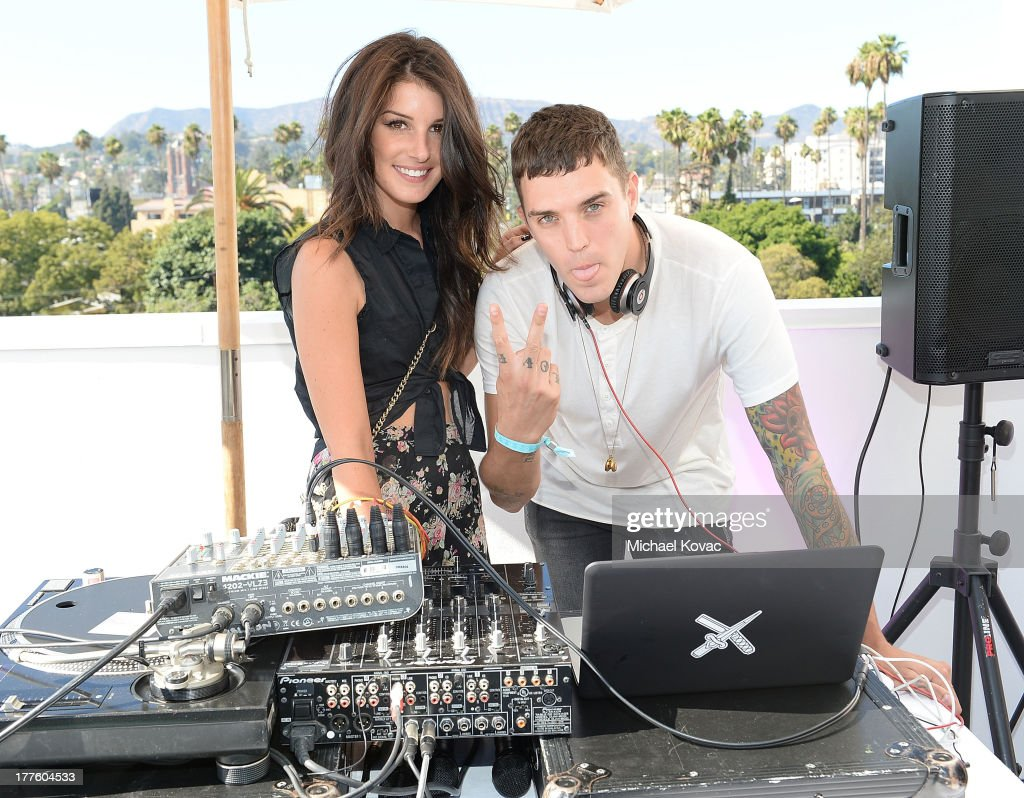 Actress Shenae Grimes and Josh Beech spin during BeautyCon LA, a fashion and beauty summit for the top digital influences online at Siren Studios on August 24, 2013 in Hollywood, California.