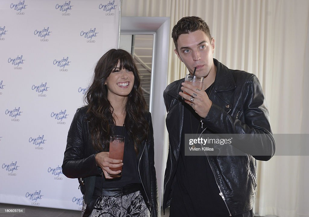 Actress <a gi-track='captionPersonalityLinkClicked' href=/galleries/search?phrase=Shenae+Grimes&family=editorial&specificpeople=2153141 ng-click='$event.stopPropagation()'>Shenae Grimes</a> and recording artist Josh Beech attend the Entertainment Tonight And Crystal Light Pre-Emmy Party at SLS Hotel on September 17, 2013 in Beverly Hills, California.