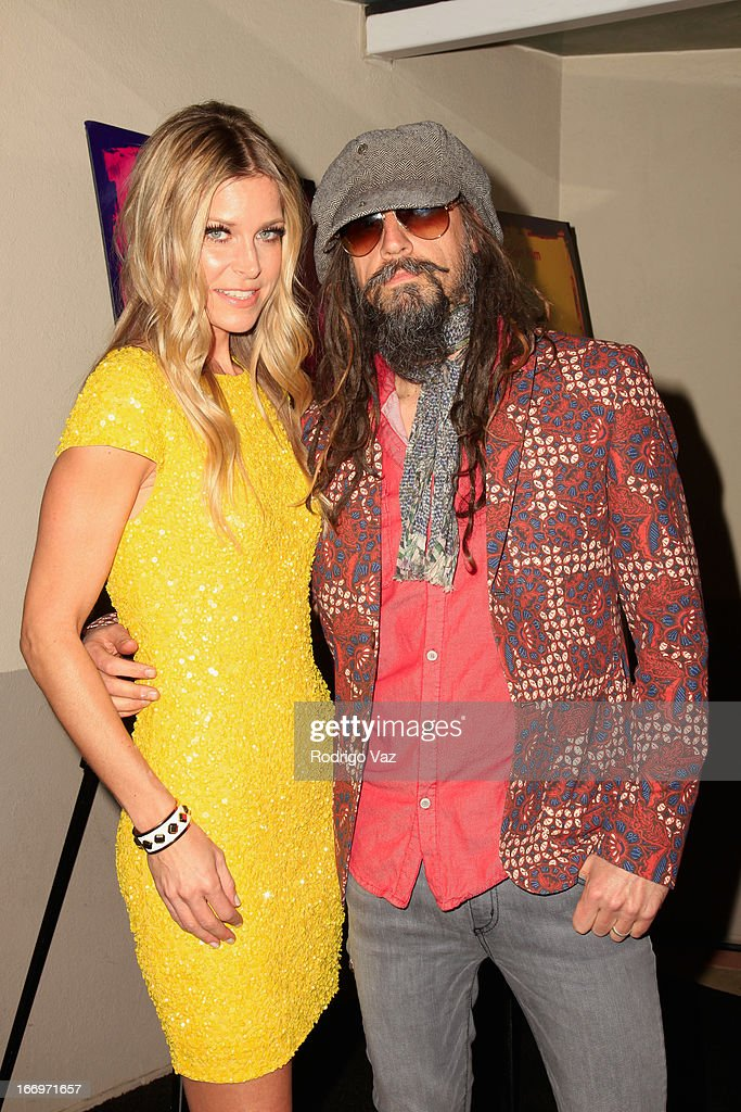 Actress <a gi-track='captionPersonalityLinkClicked' href=/galleries/search?phrase=Sheri+Moon&family=editorial&specificpeople=2360728 ng-click='$event.stopPropagation()'>Sheri Moon</a> Zombie and husband <a gi-track='captionPersonalityLinkClicked' href=/galleries/search?phrase=Rob+Zombie&family=editorial&specificpeople=217722 ng-click='$event.stopPropagation()'>Rob Zombie</a> arrive at <a gi-track='captionPersonalityLinkClicked' href=/galleries/search?phrase=Rob+Zombie&family=editorial&specificpeople=217722 ng-click='$event.stopPropagation()'>Rob Zombie</a>'s 'The Lords Of Salem' Los Angeles Premiere at AMC Burbank 16 on April 18, 2013 in Burbank, California.