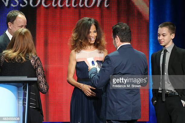 Actress Sherri Saum accepts the TCA Award for Outstanding Achievement in Youth Programming for 'The Fosters' onstage at the 31st annual Television...