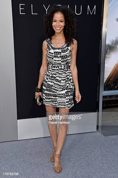 Actress Sherri Saum arrives at the premiere of TriStar Pictures' 'Elysium' at Regency Village Theatre on August 7 2013 in Westwood California