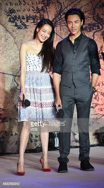 Actress Shu Qi and actor Chen Kun attend 'The Ghouls' press conference at China World Trade Center Tower III on August 7 2014 in Beijing China