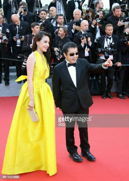 Actress Shu Qi and director Jia Zhangke arrive on the red carpet of the 70th Anniversary dinner during the 70th annual Cannes Film Festival at Palais...