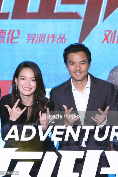 Actress Shu Qi and her husband director Stephen Fung attend the premiere of film 'The Adventurers' on August 8 2017 in Beijing China