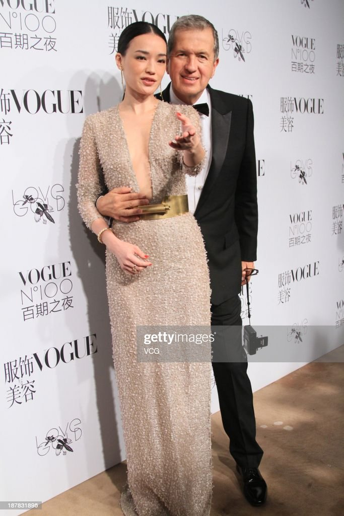Actress Shu Qi and photographer Mario Testino (R) attend the Vogue NO.100 night at Ch'ien Men 23 on November 12, 2013 in Beijing, China.