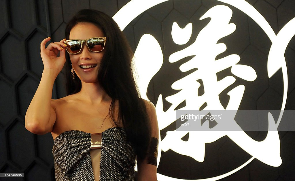 Actress Shu Qi attends Puyi optical store opening ceremony on July 28 2013 in Shanghai China
