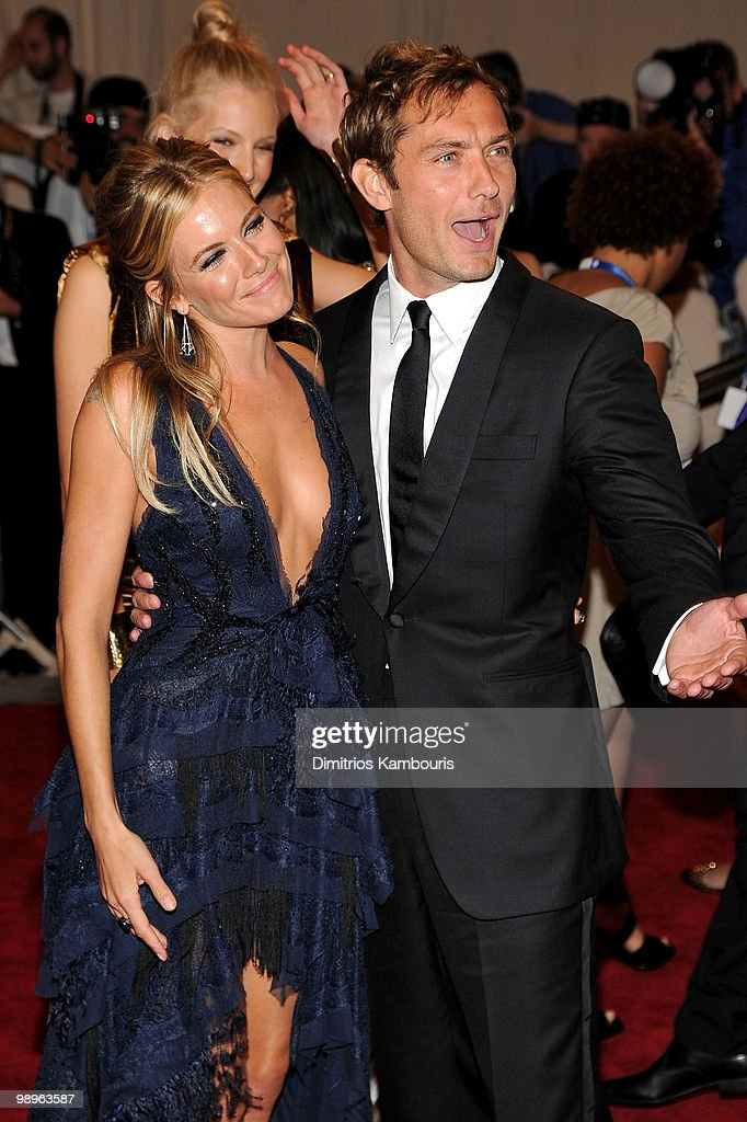 Actress Sienna Miller (L) and actor Jude Law attend the Costume Institute Gala Benefit to celebrate the opening of the 'American Woman: Fashioning a National Identity' exhibition at The Metropolitan Museum of Art on May 3, 2010 in New York City.
