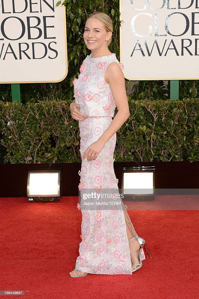 Actress <a gi-track='captionPersonalityLinkClicked' href=/galleries/search?phrase=Sienna+Miller&family=editorial&specificpeople=171883 ng-click='$event.stopPropagation()'>Sienna Miller</a> arrives at the 70th Annual Golden Globe Awards held at The Beverly Hilton Hotel on January 13, 2013 in Beverly Hills, California.