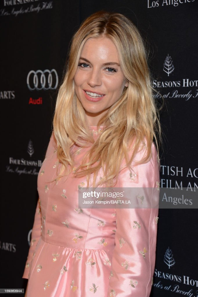 Actress <a gi-track='captionPersonalityLinkClicked' href=/galleries/search?phrase=Sienna+Miller&family=editorial&specificpeople=171883 ng-click='$event.stopPropagation()'>Sienna Miller</a> arrives at the BAFTA Los Angeles 2013 Awards Season Tea Party held at the Four Seasons Hotel Los Angeles on January 12, 2013 in Los Angeles, California.