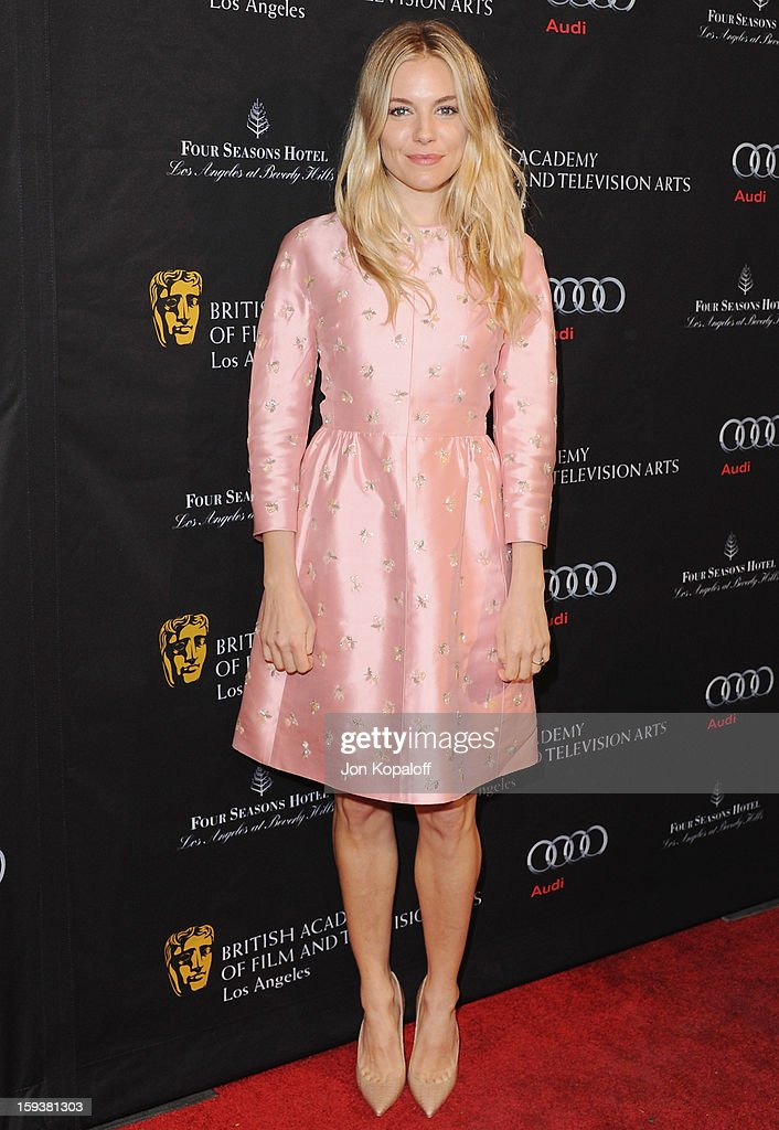 Actress <a gi-track='captionPersonalityLinkClicked' href=/galleries/search?phrase=Sienna+Miller&family=editorial&specificpeople=171883 ng-click='$event.stopPropagation()'>Sienna Miller</a> arrives at the BAFTA Los Angeles Awards Season Tea Party at Four Seasons Hotel Los Angeles at Beverly Hills on January 12, 2013 in Beverly Hills, California.