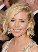 Actress Sienna Miller attends the 72nd Annual Golden Globe Awards at The Beverly Hilton Hotel on January 11 2015 in Beverly Hills California