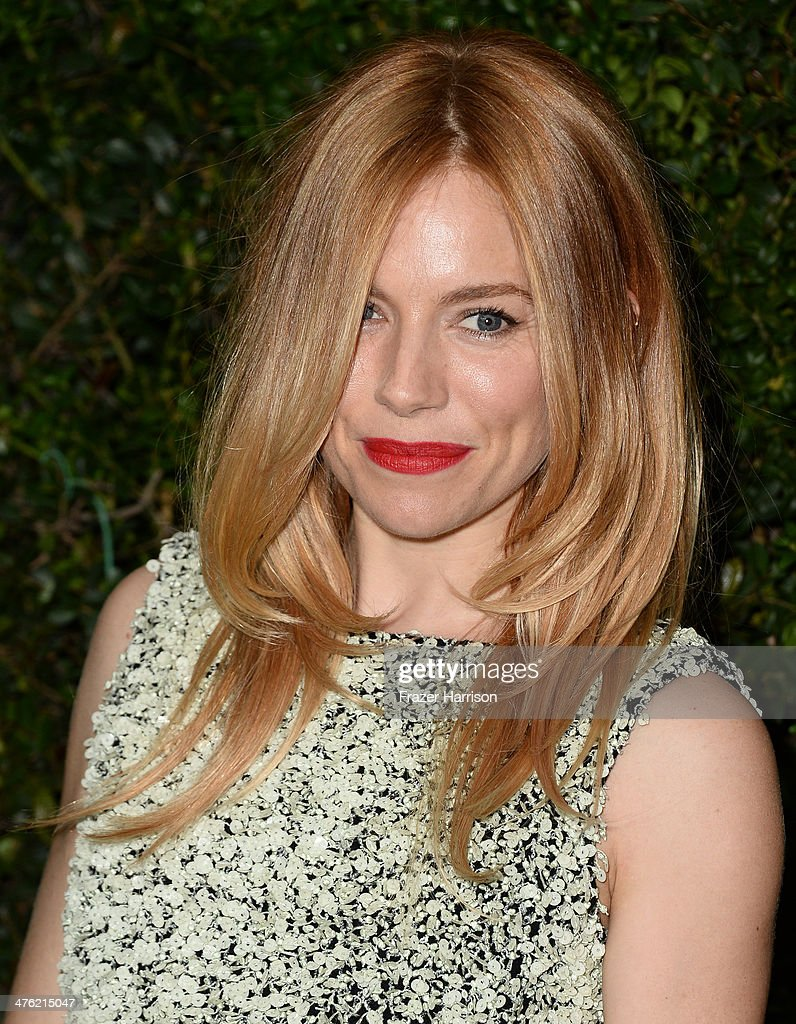 Actress Sienna Miller attends the Chanel and Charles Finch Pre-Oscar Dinner at Madeo Restaurant on March 1, 2014 in Los Angeles, California.