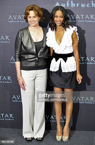US actress Sigourney Weaver poses next to US actress Zoe Saldana during a photocall for their latest movie 'Avatar' by Canadian film director James...