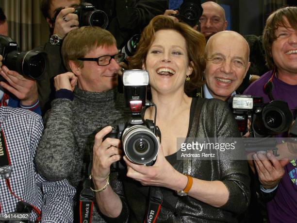 Actress Sigourney Weaver poses with photographers during a photocall to promote the film 'Avatar' at Hotel de Rome on December 8 2009 in Berlin...