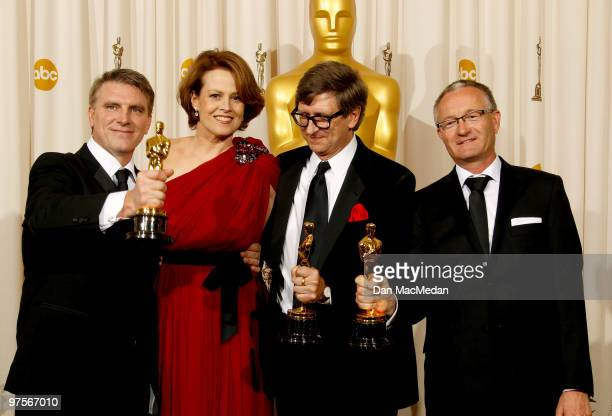 Actress Sigourney Weaver stands with Rick Carter Robert Stromberg and Kim Sinclair with their Oscar for Achievement in Art Direction for 'Avatar' in...