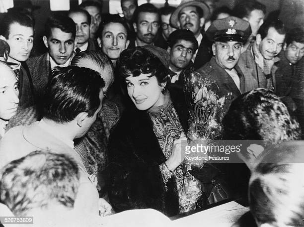 Actress Silvana Pampanini surrounded by fans as she arrives in Istanbul December 30th 1954