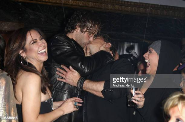 Actress Simone Thomalla and her daughter Sophia Thomalla laugh as Silvio Heinevetter kisses Sven Martinek at the Lambertz Monday Night Schoko Fashion...