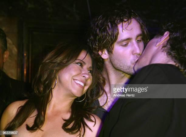 Actress Simone Thomalla laughs as Silvio Heinevetter kisses Sven Martinek at the Lambertz Monday Night Schoko Fashion party at the Alten Wartesaal on...