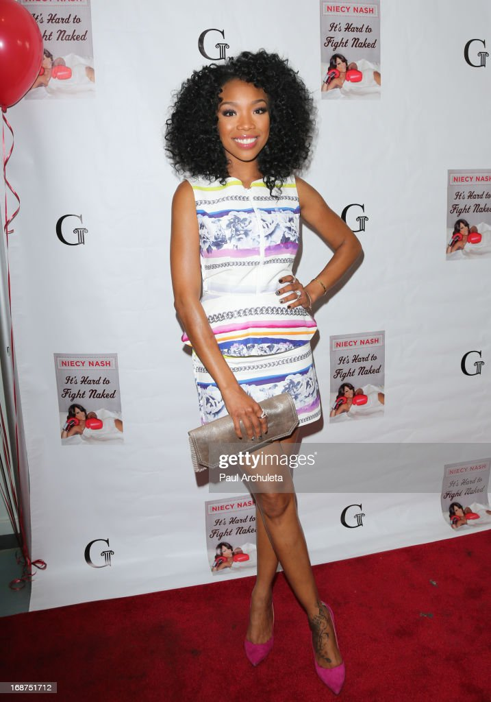 Actress / Singer <a gi-track='captionPersonalityLinkClicked' href=/galleries/search?phrase=Brandy+Norwood&family=editorial&specificpeople=202122 ng-click='$event.stopPropagation()'>Brandy Norwood</a> attends the release party for Niecy Nash new book 'It's Hard To Fight Naked' at the Luxe Rodeo Drive Hotel on May 14, 2013 in Beverly Hills, California.