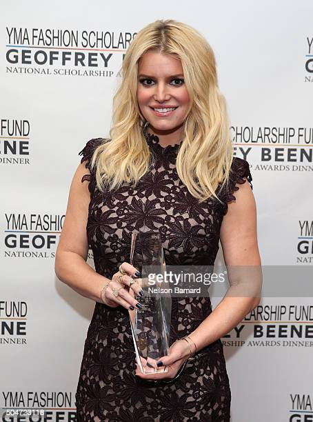 Actress Singer Fashion Entrepreneur Jessica Simpson poses with her award during YMA Fashion Scholarship Fund Geoffrey Beene National Scholarship...