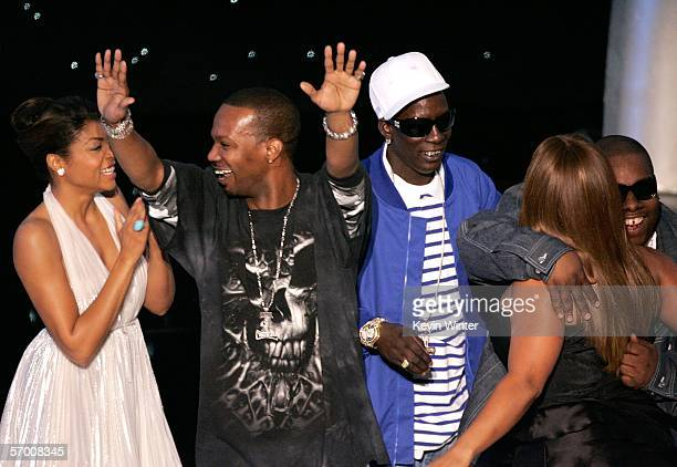 Actress singer Taraji Henson musical artist 'DJ Paul' Paul Beauregard Project Pat look on as Crunchy Black hugs Queen Latifah on stage after Three 6...