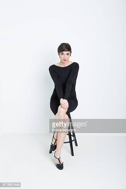 actress sitting on stool