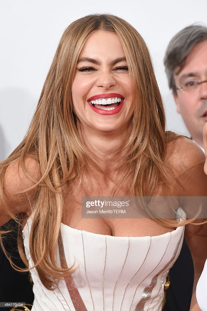 Actress Sofía Vergara winner of the Outstanding Comedy Series Award for 'Modern Family' poses in the press room during the 66th Annual Primetime Emmy...