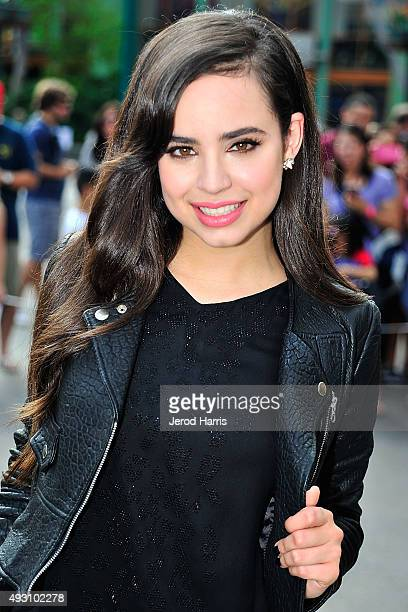 Actress Sofia Carson of Disney's 'Descendants' performs and joins fans at Downtown Disney at Disneyland Resort on October 17 2015 in Anaheim...