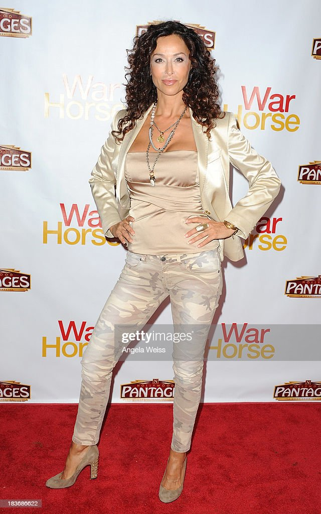 Actress <a gi-track='captionPersonalityLinkClicked' href=/galleries/search?phrase=Sofia+Milos&family=editorial&specificpeople=204487 ng-click='$event.stopPropagation()'>Sofia Milos</a> arrrives at the opening night for 'War Horse' at the Pantages Theatre on October 8, 2013 in Hollywood, California.