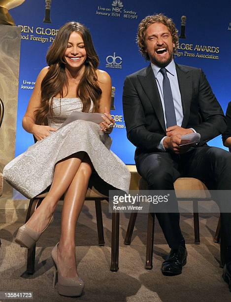 Actress Sofia Vergara and actor Gerard Butler onstage during the 69th annual Golden Globe Award Nominations announcements at The Beverly Hilton hotel...