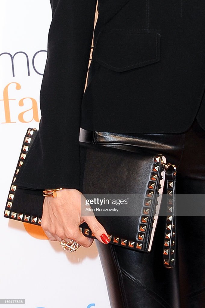 Actress Sofia Vergara (purse detail) arrives at the 'Modern Family' Fan Appreciation Day hosted by USA Network at Westwood Village on October 28, 2013 in Los Angeles, California.