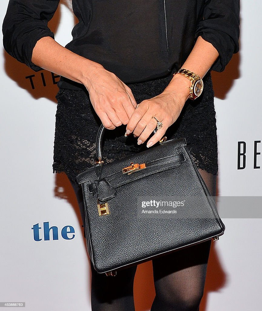 Actress Sofia Vergara (clutch detail) arrives at the 'Tie The Knot' grand store opening at The Beverly Center on December 5, 2013 in Los Angeles, California.