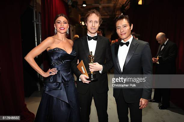 Actress Sofia Vergara director Laszlo Nemes winner of the Best Foreign Language Film award for 'Son of Saul' and Lee Byunghun backstage at the 88th...