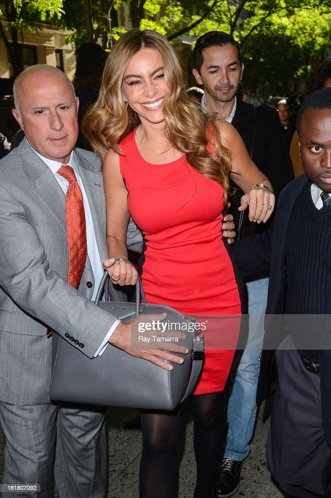 Actress <a gi-track='captionPersonalityLinkClicked' href=/galleries/search?phrase=Sofia+Vergara&family=editorial&specificpeople=214702 ng-click='$event.stopPropagation()'>Sofia Vergara</a> enters the 'Live With Kelly And Michael' taping at the ABC Lincoln Center Studios on September 25, 2013 in New York City.