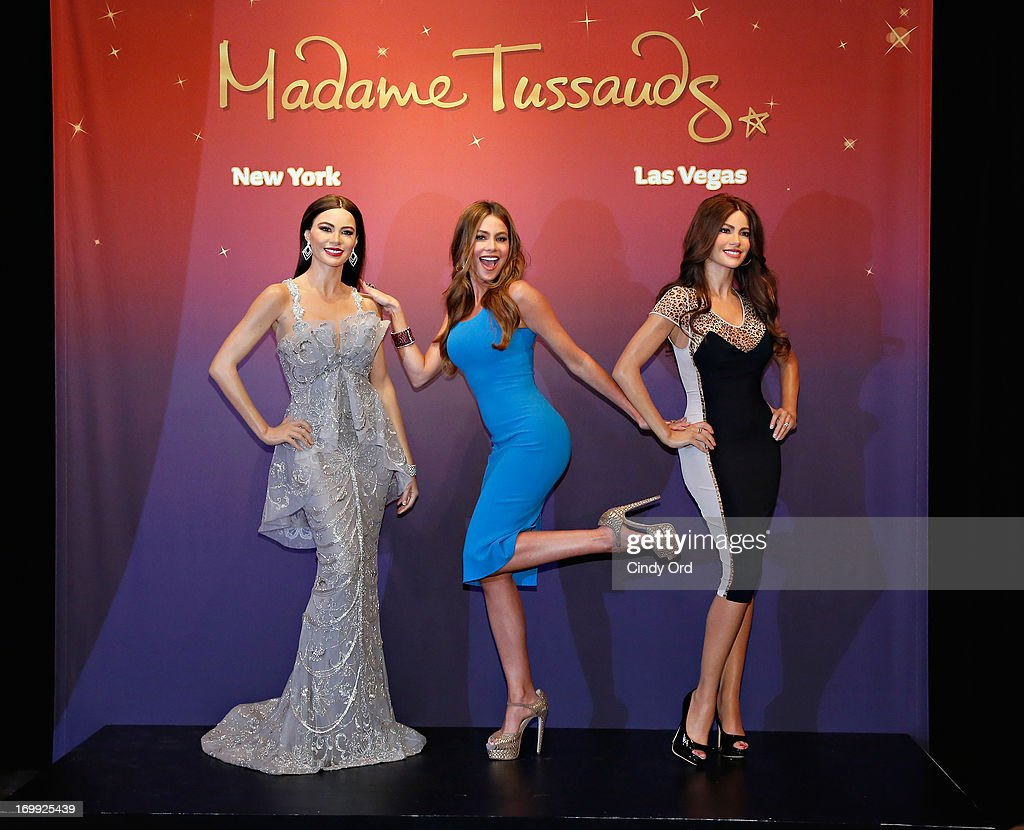 Actress <a gi-track='captionPersonalityLinkClicked' href=/galleries/search?phrase=Sofia+Vergara&family=editorial&specificpeople=214702 ng-click='$event.stopPropagation()'>Sofia Vergara</a> (C) unveils two Madame Tussauds wax figures in her likeness for display at Madame Tussauds locations in New York and Las Vegas on June 4, 2013 in New York City.