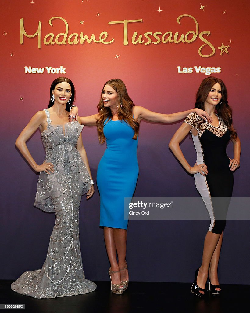 Actress Sofia Vergara (C) unveils two Madame Tussauds wax figures in her likeness for display at Madame Tussauds locations in New York and Las Vegas on June 4, 2013 in New York City.