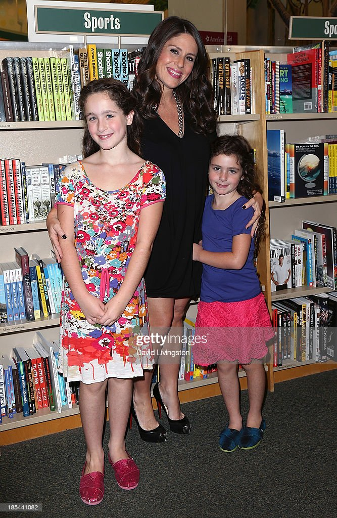 Actress Soleil Moon Frye and daughters Poet Sienna Rose Goldberg and Jagger Joseph Blue Goldberg attend a signing for her book 'Let's Get This Party...
