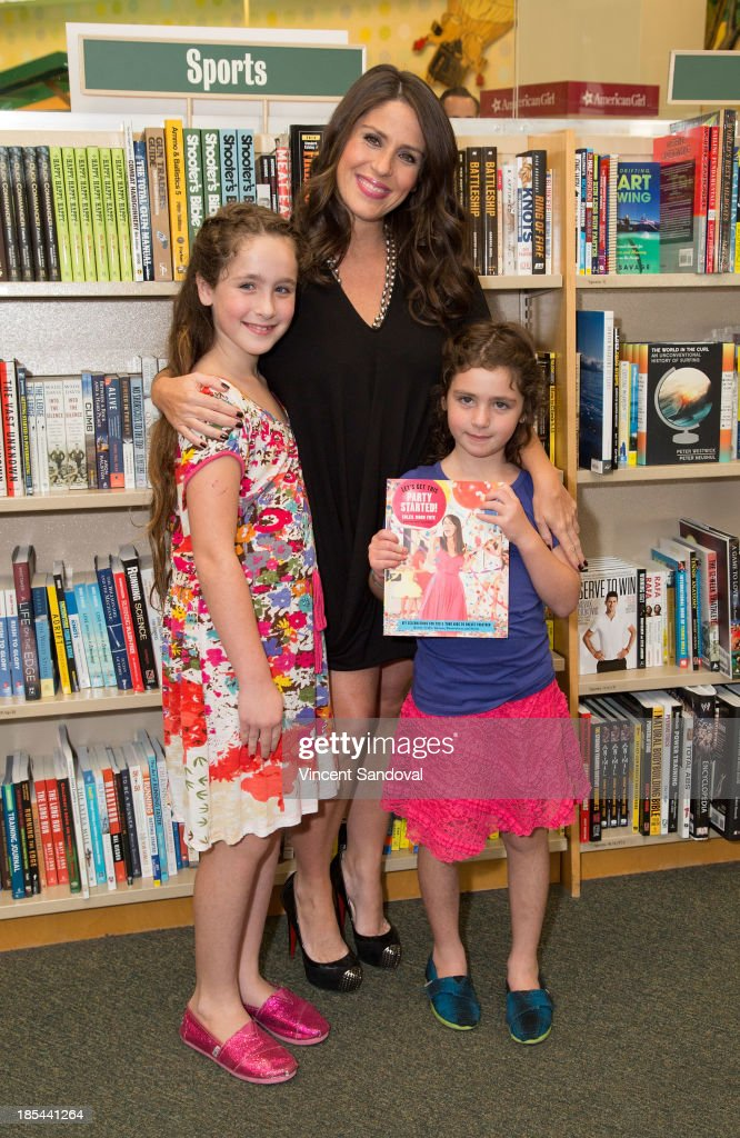 Actress Soleil Moon Frye and daughters Poet Sienna Rose Goldberg and Jagger Joseph Blue Goldberg attend a signing of her new book 'Let's Get This...
