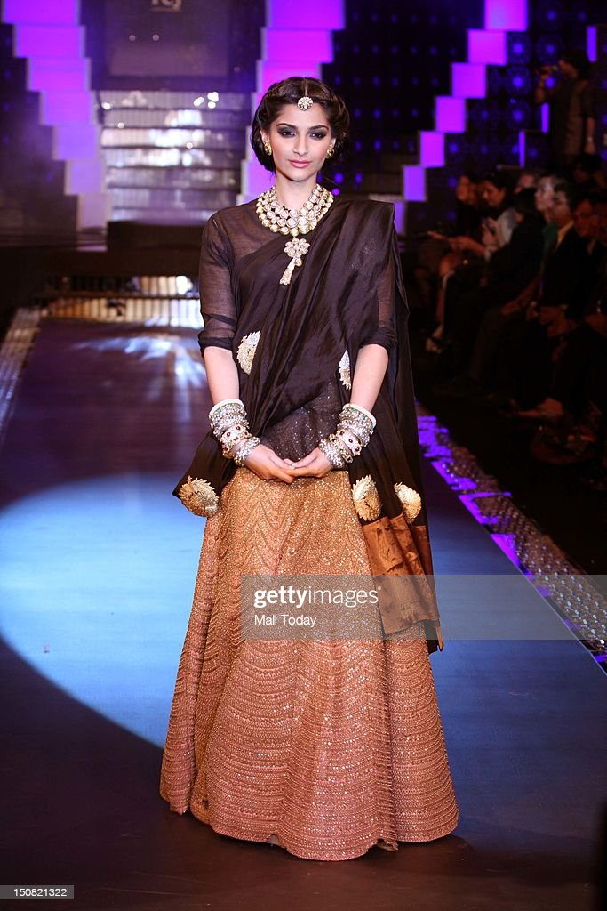 Actress Sonam Kapoor showcases jewellery creations by designer group PC Jewellers during the grand finale of the third season of India International Jewellery Week (IIJW)in Mumbai.