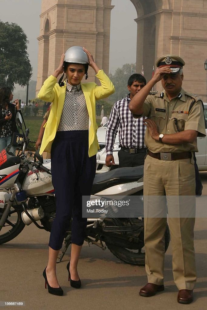 Actress Sonam Kapoor with JCP (Traffic) Delhi Police, Satyendra Garg during a campaign to create awareness among women to wear helmets while seated on two wheelers, at India Gate in New Delhi on Saturday.