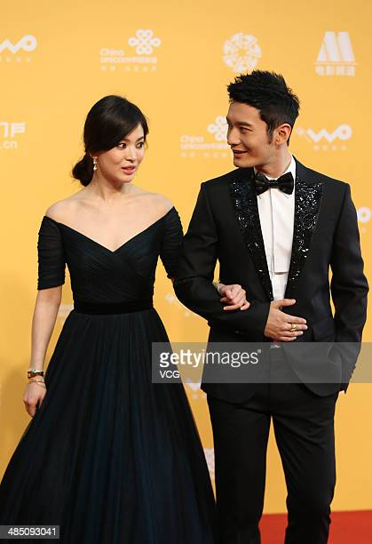 Actress Song Hyekyo and actor Huang Xiaoming arrive for the red carpet of 4th Beijing International Film Festival at China's National Grand Theater...