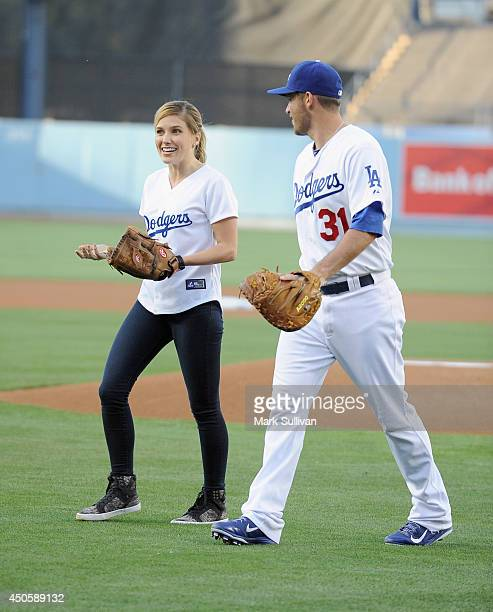 Actress Sophia Bush leaves the field with Dodger player Drew Butera after throwing out the ceremonial first pitch before the game between the Arizona...
