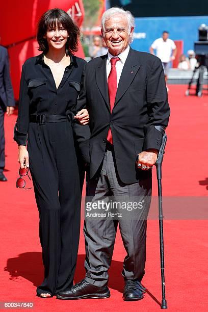 Actress Sophie Marceau and actor Jean Paul Belmondo attend the Golden Lion For Jean Paul Belmondo followed by the 'Le Voleur' Premiere during the...