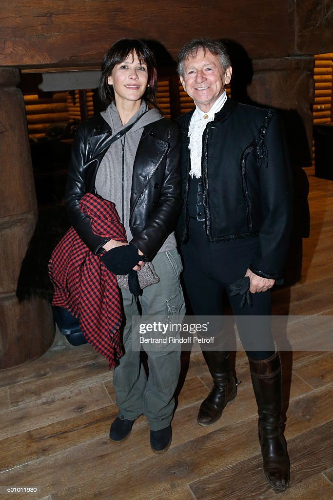Actress Sophie Marceau and Mario Luraschi attend the 'Mario Luraschi's Espace Cavalcade' : Opening Night at Ferme De La Chapelle on December 11, 2015 in Ermenonville, near Paris, France.