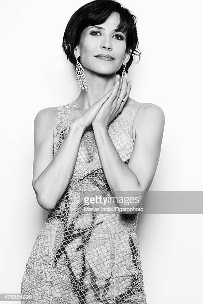 Actress Sophie Marceau is photographed for Madame Figaro on May 24 2015 at the Cannes Film Festival in Cannes France Dress earrings and ring Makeup...